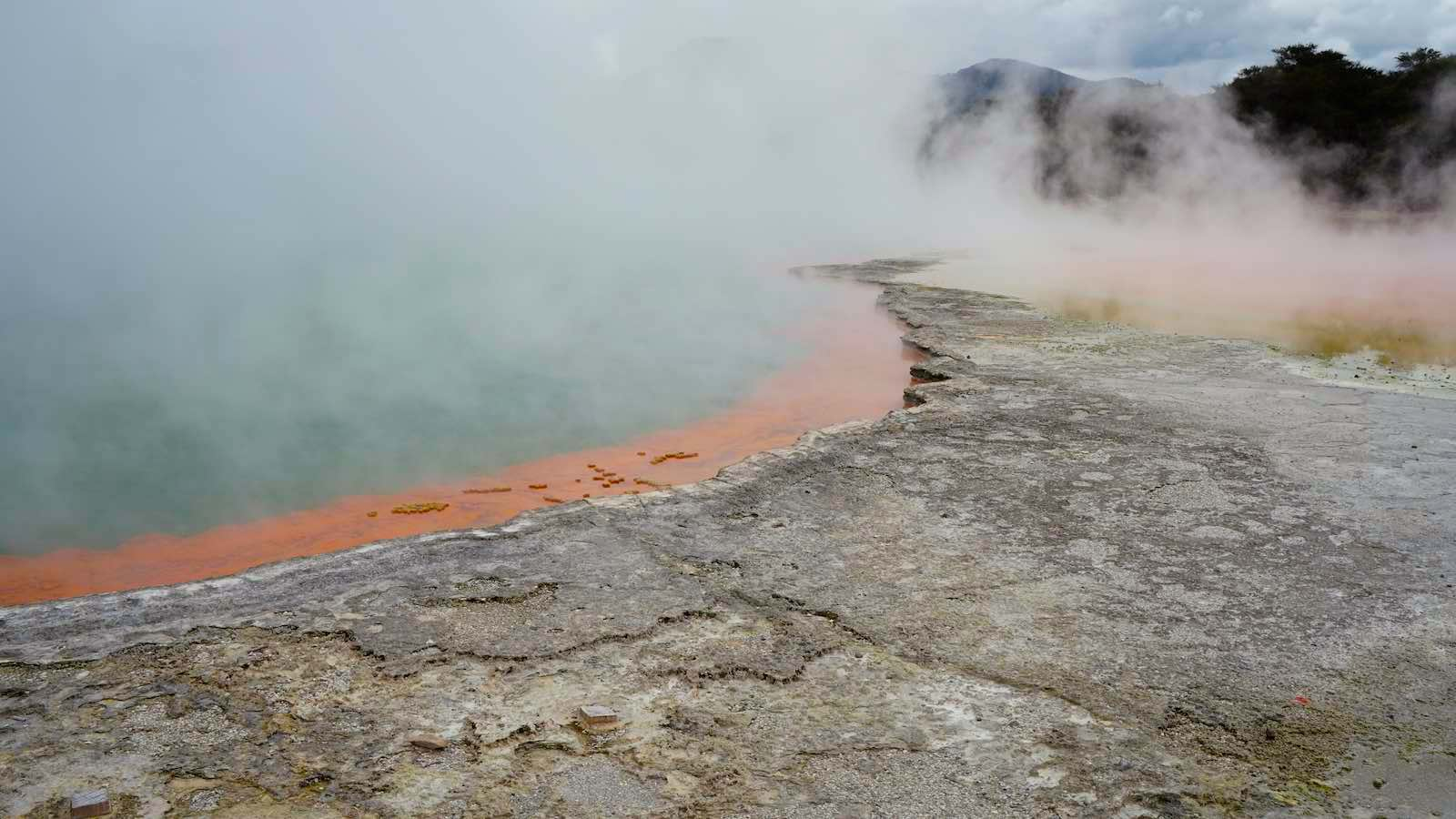 Colorful hot spring, although you probably wouldn't want to bathe in this, apparently the orange comes from an arsentic compound