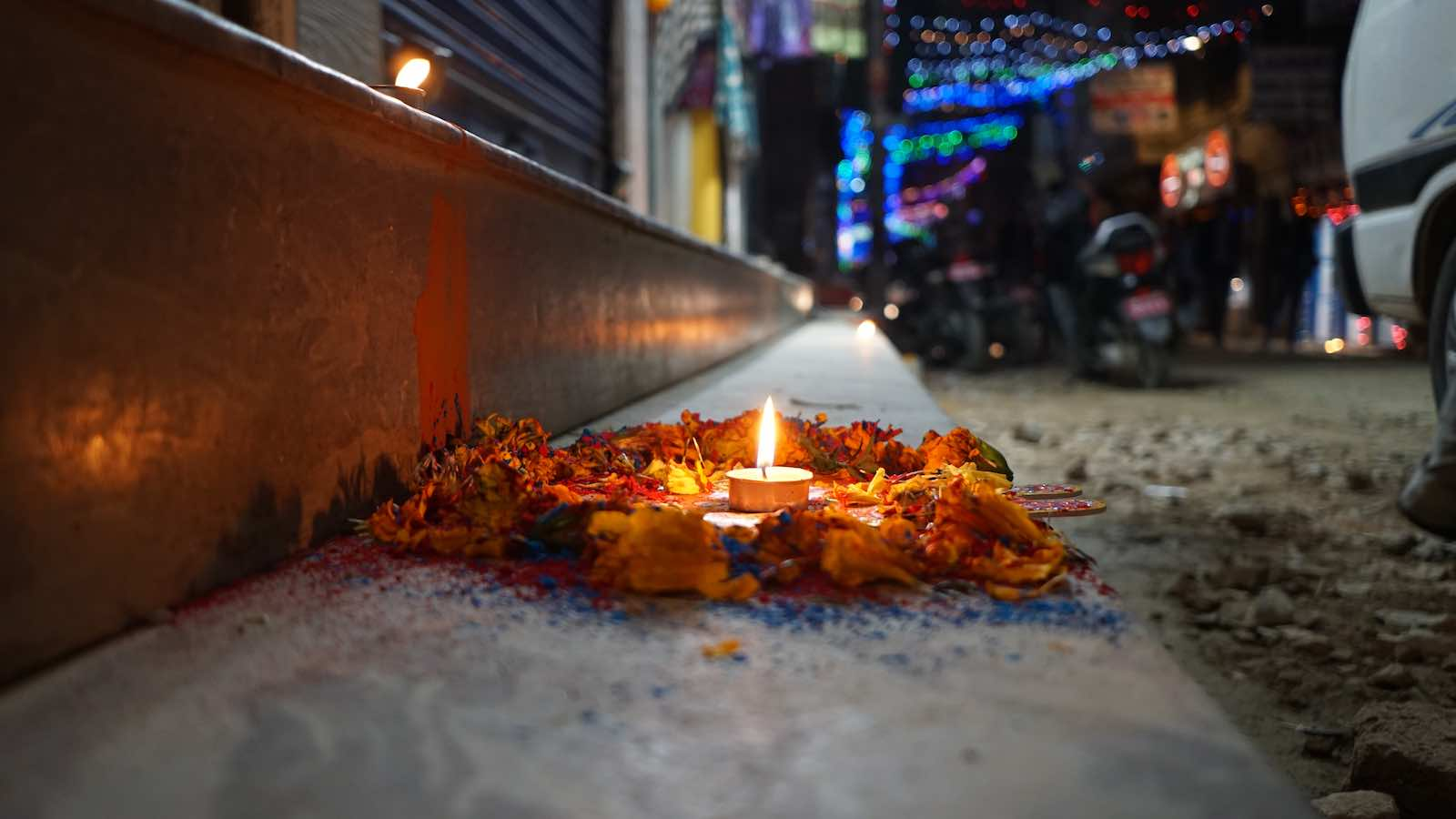 I got here right during Diwali, and on one of the nights every shop put out these offerings or a colorful flower pattern called Rangoli in front of their shop.